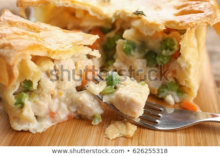 Stock vector : An image of a chicken pot pie cartoon character