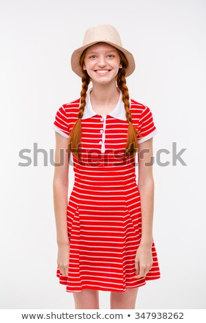Amusing positive girl with two braids in boonie hat  Stock photo © deandrobot