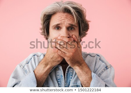 Shocked stunned young man covered mouth by hands Stock photo © deandrobot
