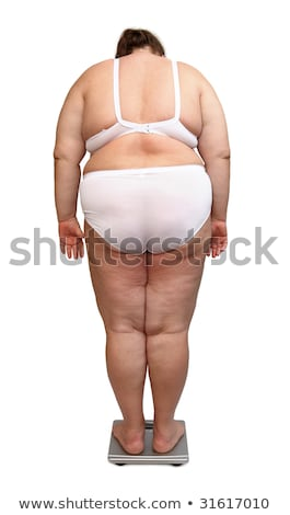 Stock photo: women with overweight from behind on scales