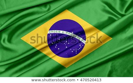 Brazil national flag background texture and football. Stock photo © jabkitticha