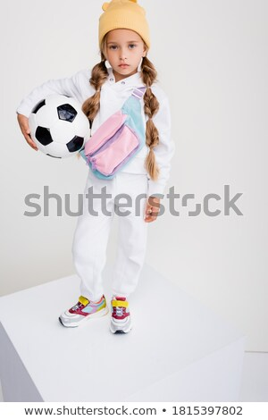 Blonde sports girl with cube stand Stock photo © bezikus