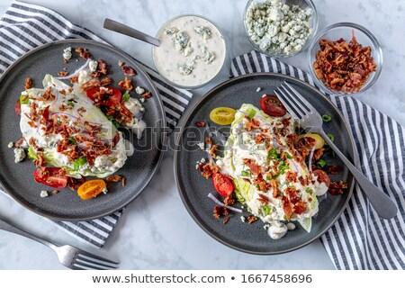 Gelo alface tomates folhas prato salada Foto stock © Digifoodstock