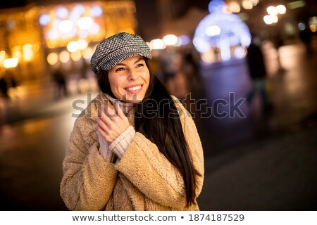 Young people on the night city street freezing of cold Stock photo © zurijeta