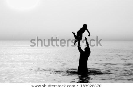 Negro hijo de padre nadar África hombre negro hijo Foto stock © lienkie
