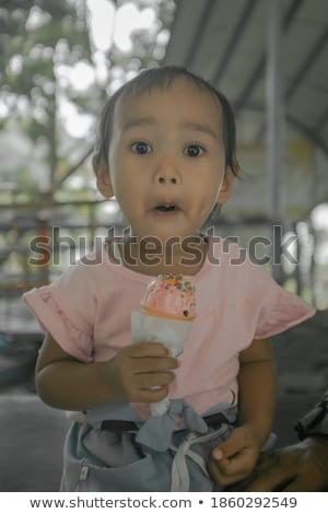 held smile expression of a girl Stock photo © Giulio_Fornasar