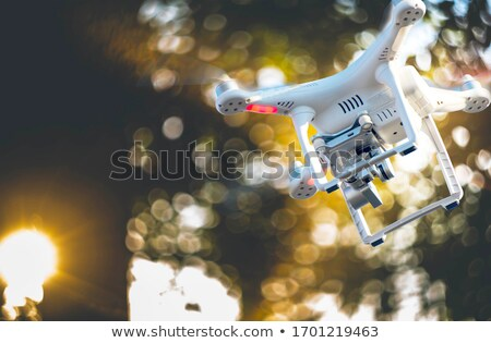 drone copter landing in hand and holding on white background stock photo © frameangel
