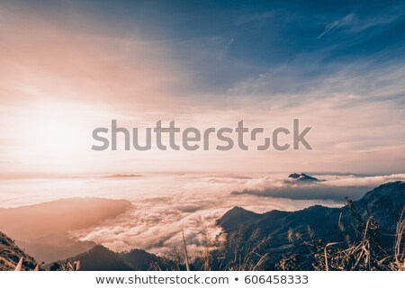 Sunrise at mountain in Sienna-Blue color two tone Stock photo © Yongkiet
