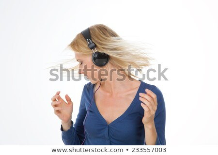 Profile of pretty blonde young woman shaking her hair Stock photo © deandrobot