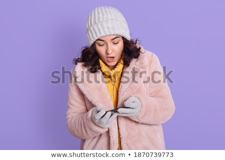 young beautiful fashionable woman in pink fur coat holding mobil stock photo © victoria_andreas