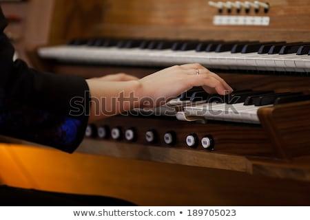 Mani donna giocare chiesa pipe organo Foto d'archivio © bubutu