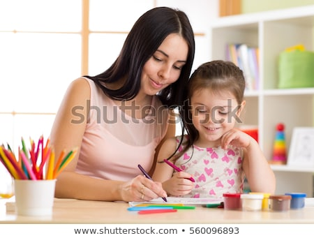 Feliz nina dibujo casa mamá lápices Foto stock © tekso
