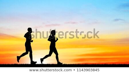 Woman cross country running on trail Stock photo © blasbike