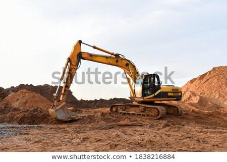 Trabalhando amarelo escavadora montanha laranja móvel Foto stock © anyunoff