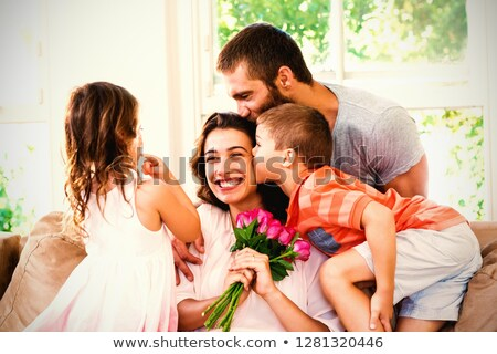 Happy mother holding roses sitting with her son and daughter on  Stock photo © wavebreak_media