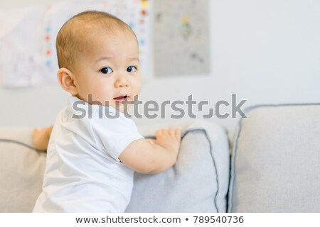 adorable chinese and caucasian baby boy playing on the floor stock photo © feverpitch