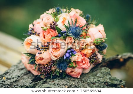 Young caucasian groom with a bridal bouquet. Stock photo © RAStudio