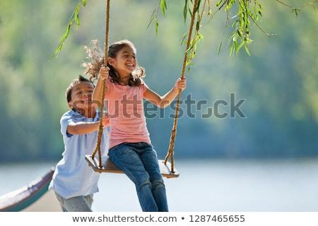 criança · balançar · jovem · jogar · crianças · laranja - foto stock © is2