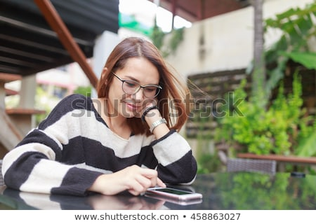 portrait of a smiling young woman wearing smart watch stock photo © deandrobot