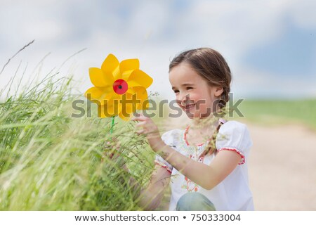 young girl playing with toy windmill Stock photo © IS2