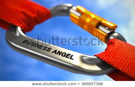 Business Angel on Chrome Carabiner between Red Ropes. Stock photo © tashatuvango