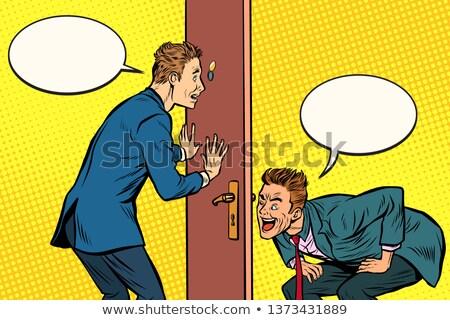 Two men spy each other through the door Stock photo © studiostoks