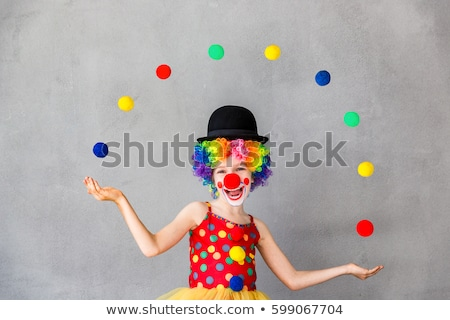 girl and clown juggling balls stock photo © bluering