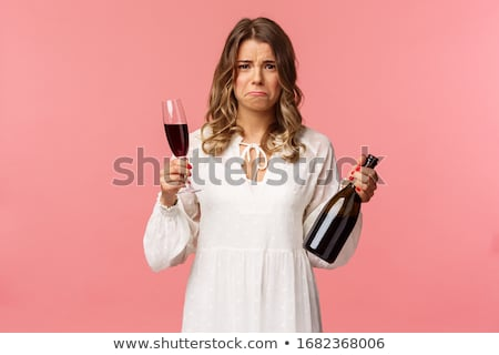 Blonde woman holding wine bottle and glass Stock photo © Traimak