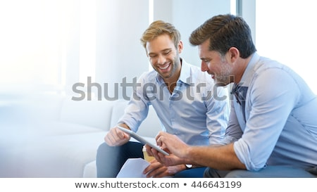 smiling business man in discussion stock photo © is2