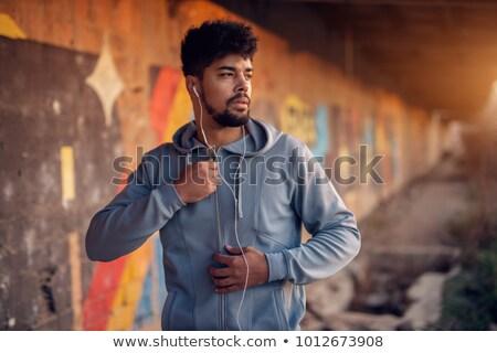 Portré szakállas férfi fülhallgató ül kint Stock fotó © deandrobot