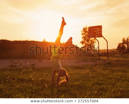 Handstand in a field Stock photo © IS2