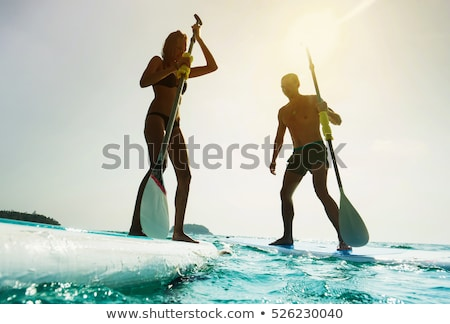 Couple standing on beach with surfboards Stock photo © IS2