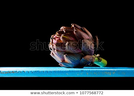 Purple artichokes at backlight in a darkness ambient. Stock photo © Photooiasson