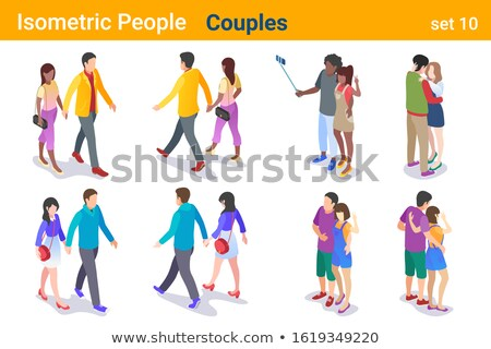 Couple kissing in front of crowd Stock photo © IS2