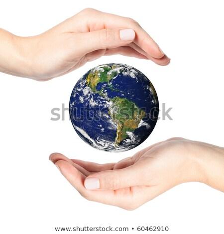 female hands surrounding the world map on white  Stock photo © inxti