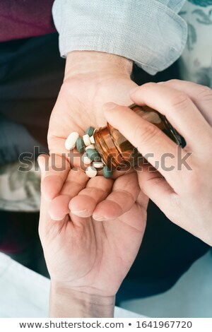 doctor man giving some pills to a senior man Stock photo © nito