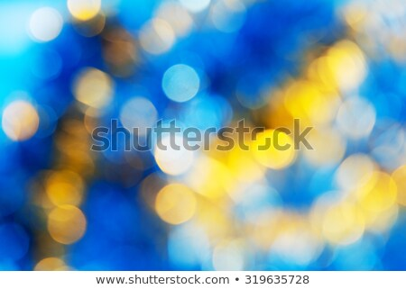 Green blue yellow blurred background with bokeh lights  Stock photo © TasiPas