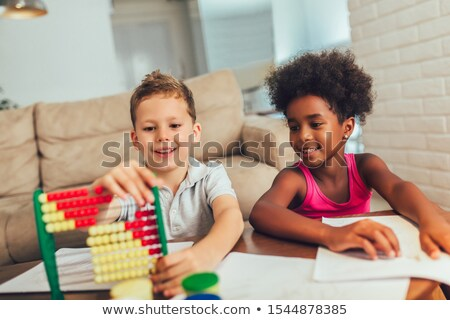An african kid learning abacus Stock photo © bluering
