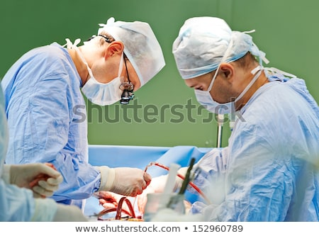 Two Surgeons Operating On A Patient Stock photo © monkey_business