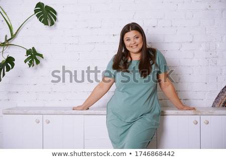 Attractive overweight woman Stock photo © Traimak