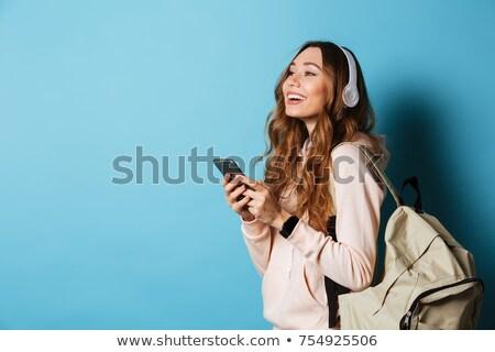 Portré boldog fiatal lány fülhallgató hátizsák ül Stock fotó © deandrobot