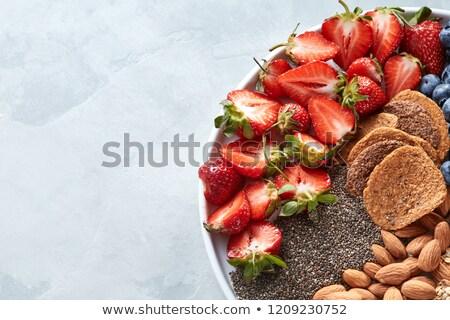 Alimentos saludables ingredientes avena granola fresa semillas Foto stock © artjazz