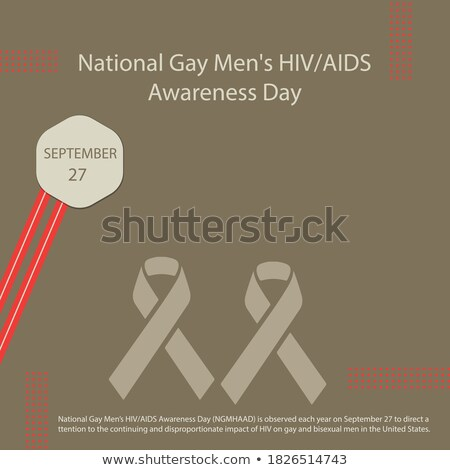 man with gay pride rainbow awareness ribbon Stock photo © dolgachov