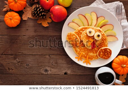 Pumpkin pancakes with apples topping Stock photo © zoryanchik
