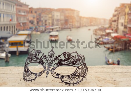 venice italy venetian masks on bridge agaist landscape grand canal stock photo © artfotodima