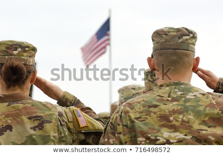 Patriotic Soldier Saluting American Flag Stock photo © Krisdog