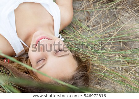 Young girl lying on a sand dune Stock photo © iko