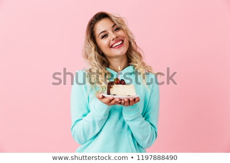 Photo of happy woman in basic clothing holding piece of birthday Stock photo © deandrobot