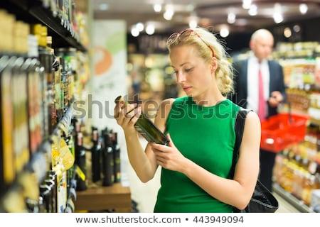 Kadın zeytinyağı süpermarket bakkal satış Stok fotoğraf © dolgachov