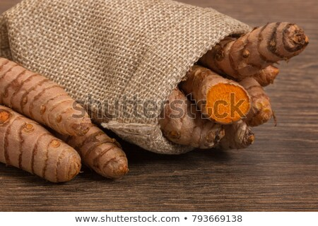 stack of turmeric on grunge wooden background Stock photo © ivo_13
